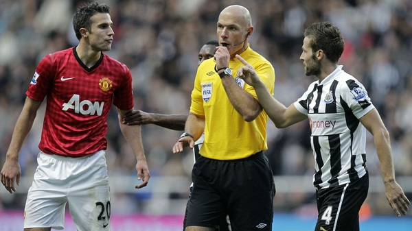 Robin van Persie and Yohan Cabaye have to be separated by referee Howard Webb