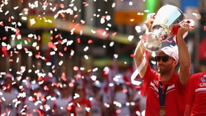 Jarrad McVeigh holds the premeirship cup during the Sydney Swans AFL Grand Final celebration street parade
