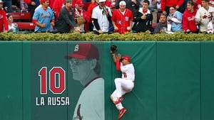 Jon Jay of the St. Louis Cardinals makes a catch against the wall of the Washington Nationals