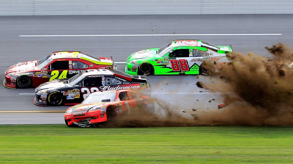 Jamie McMurray spins into the dirt after a NASCAR incident at Talladega Superspeedway