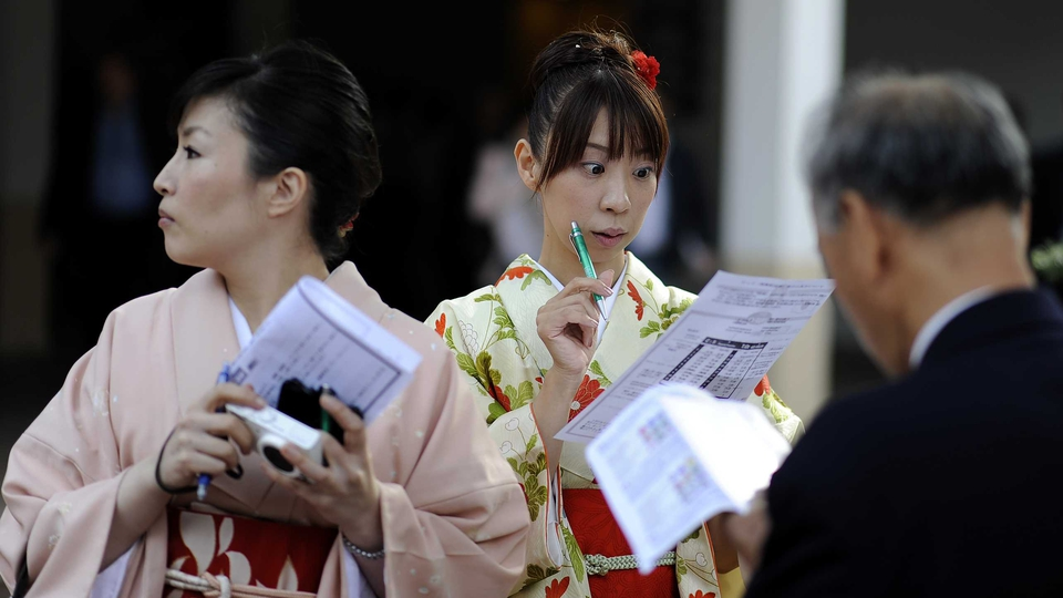 Japanese punters study the form at Longchamp