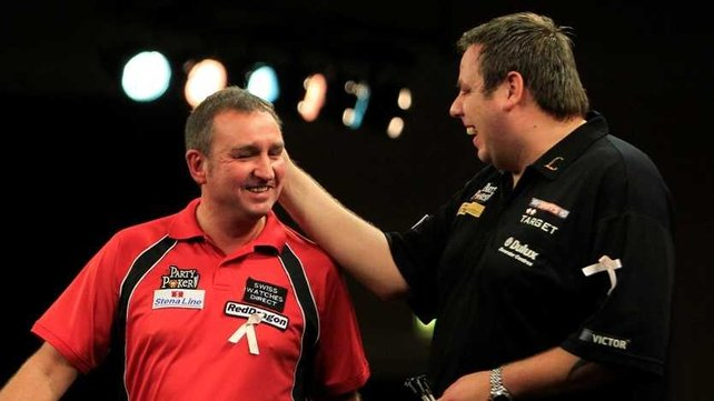 Adrian Lewis (R) saw off Richie Burnett (L)