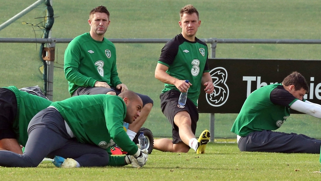 Robbie Keane takes a break after picking up an Achilles injury at training