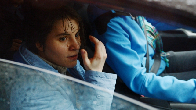 Yekaterina Samutsevich sits in a car outside the Moscow court after being released
