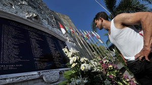 Bali bomb survivor Phil Britten reads the names of the victims on a memorial in Kuta ahead of the ten-year anniversary of the 12 October 2002 attack