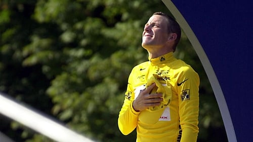 Lance Armstrong celebrates his 2001 Tour de France win, which was later taken off him