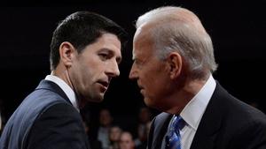 Paul Ryan and Joe Biden shake hands at the end of the US Vice Presidential debate in Danville in Kentucky