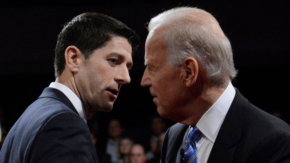 Paul Ryan and Joe Biden shake hands at the end of the US Vice Presidential debate in Danville in Kentucky