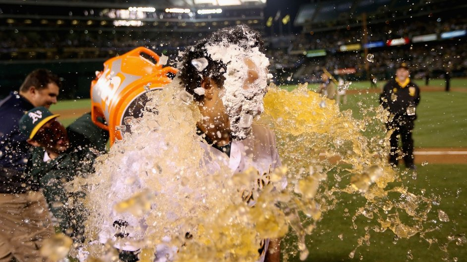 Baseball player Coco Crisp is soaked with Gatorade after he had a pie put over his face after he hit a game-winning single to beat the Detroit Tigers