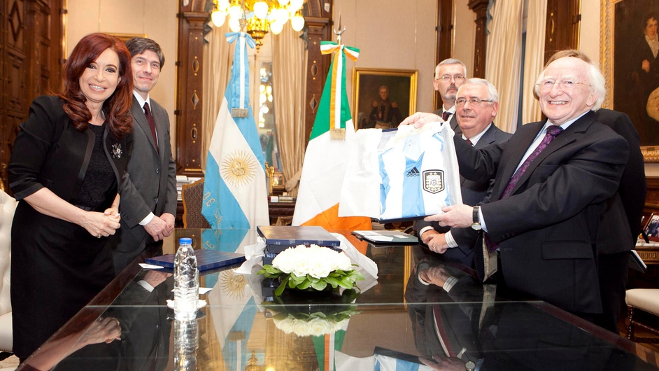 President Michael D Higgins is presented with an Argentina football jersey by his counterpart Cristina Fernández de Kirchner