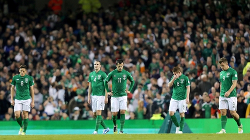 A desolated Republic of Ireland side leave the field in the wake of their drubbing by a rampant Germany