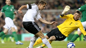 Miroslav Klose slots home the fourth goal.....