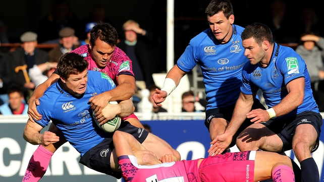 Brian O'Driscoll is tackled by Jason Shoemark and Phil Dollman