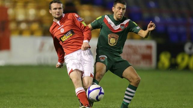 Match-winner Conan Byrne (l) battles for possession with Cork City's Shane Duggan