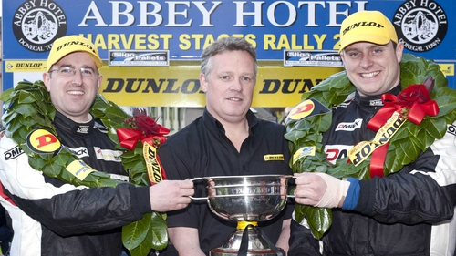 Brian O'Mahony and co-driver John Higgins celebrate their championship victory