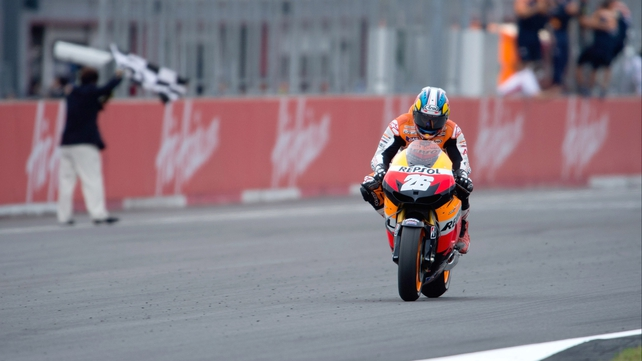 Dani Pedrosa crosses the finish line in Japan