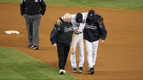 Derek Jeter of the New York Yankees is carried off after fracturing his ankle