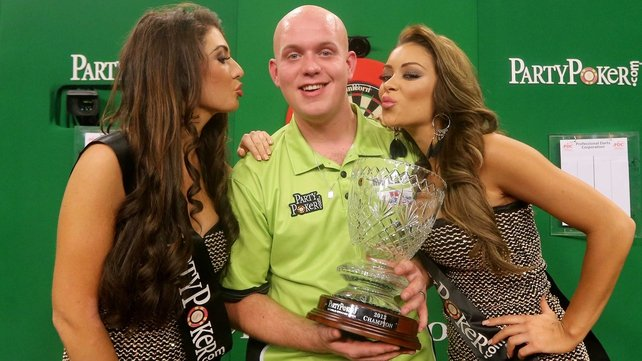 A delighted Michael van Gerwen poses with his trophy at Citywest