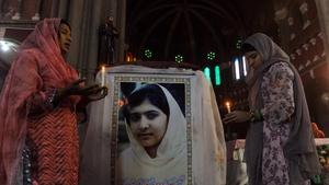 Pakistani Christians attend a mass praying for Malala Yousafzai