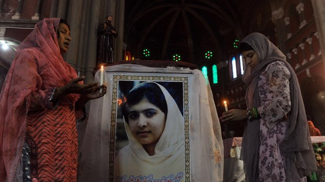 Pakistani Christians attend a mass praying for Malala Yousafzai