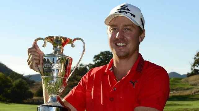 Jonas Blixt of Sweden poses with the trophy after winning the Frys.com Open
