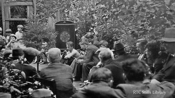 Neighbours gathered at the house of Christy O'Riordan  to hear the 1933 All-Ireland Senior Hurling Final on Radio Éireann. O'Neill Street, Clonmel 1933