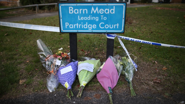 Floral tributes are left for the victims of the house fire in Essex