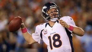 Quarterback Peyton Manning of the Denver Broncos drops back to pass against the San Diego Chargers