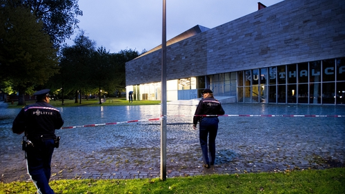 Police stand guard at the Rotterdam Kunsthal museum after the robbery