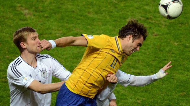 Swedish forward Johan Elmander (r) and Germany's defender Per Mertesacker