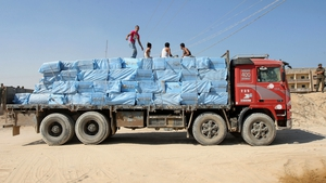 A Palestinian truck carrying goods smuggled through tunnels leaves the Gaza-Egypt border in Rafah in the southern Gaza
