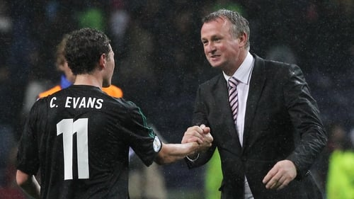 Northern Ireland's Corry Evans, and manager Michael O'Neill, celebrate holding Portugal to a draw