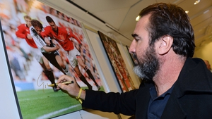 Eric Cantona signs pictures during a visit to the Golden Foot 2012 photo exhibition in Monte-Carlo
