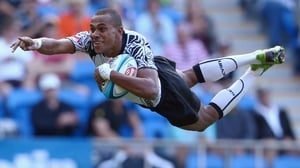 Fiji's Ilai Tinai dives over to score a try against South Africa at the 2012 Gold Coast Sevens in Australia