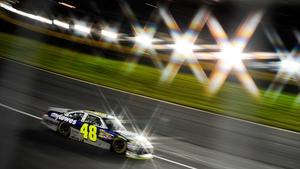 Jimmie Johnson races during the NASCAR Sprint Cup Series at Charlotte Motor Speedway