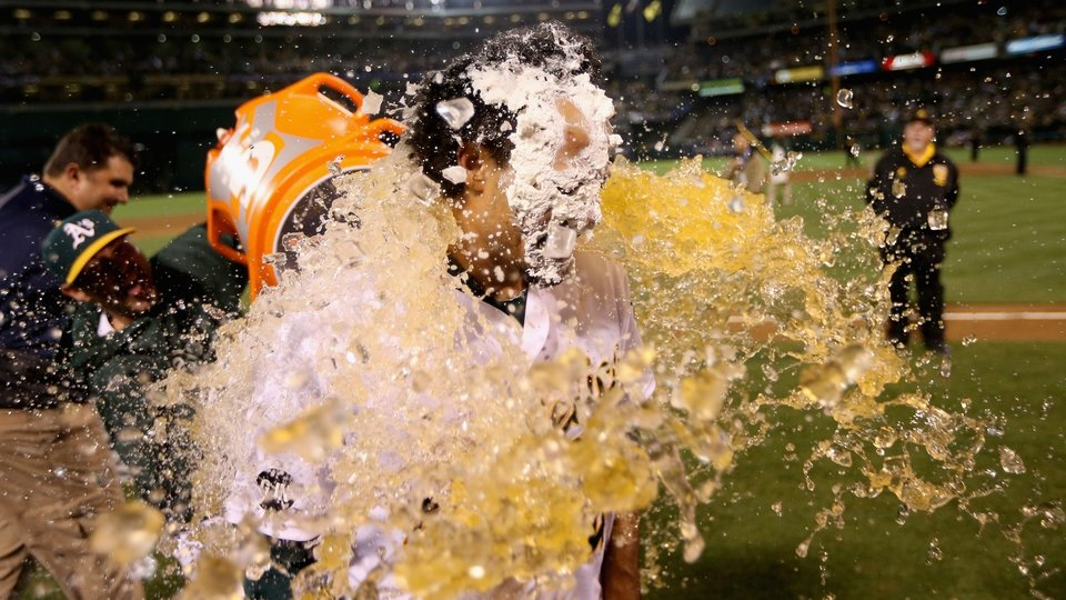 Coco Crisp of the Oakland Athletics is soaked after hitting a game-winning single to beat the Detroit Tigers in October