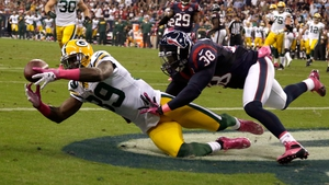 James Jones of the Green Bay Packers catches a pass for a touchdown against Houston