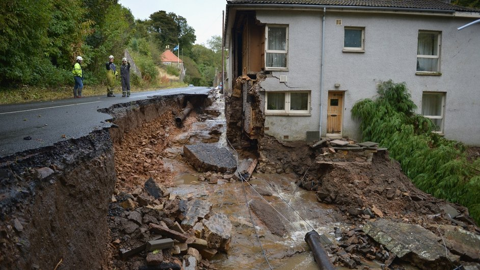 Workers inspect the damage caused by localised flooding in Dura Den, Scotland