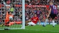 Rooney double sees United to victory
