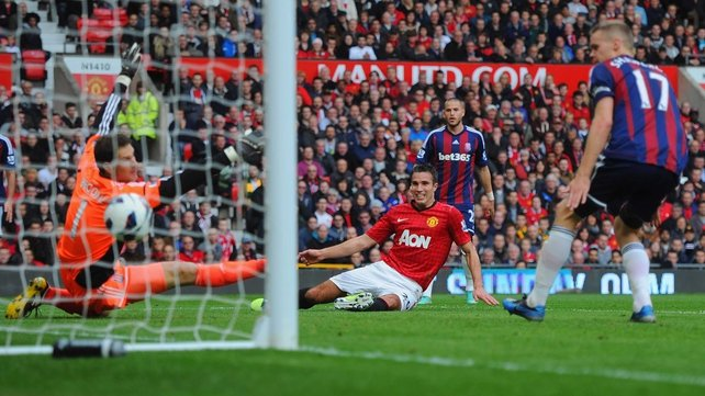 Robin van Persie watches his effort cross the line