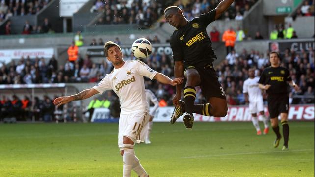 Maynor Figueroa of Wigan challenges Swansea's Pablo Hernandez