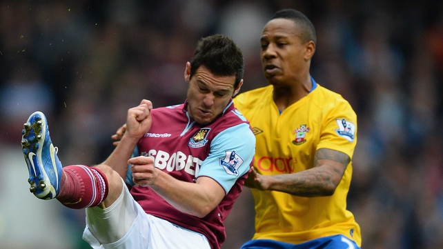 Nathaniel Clyne of Southampton and West Ham's Matt Jarvis battle for possession