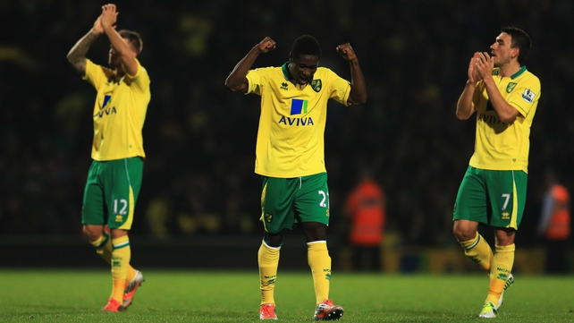 Anthony Pilkington, Alex Tettey and Robert Snodgrass celebrate at the final whistle