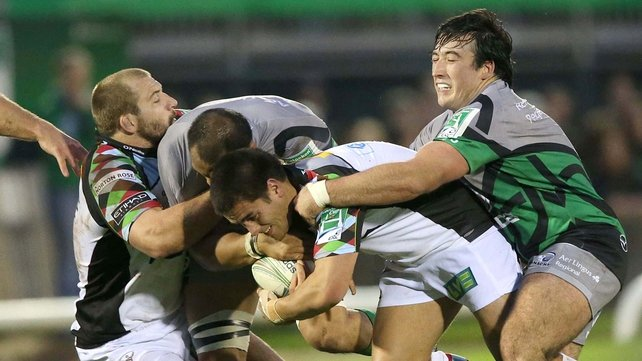 Dennis Buckley of Connacht attempts to tackle Harlequins' Ben Botica