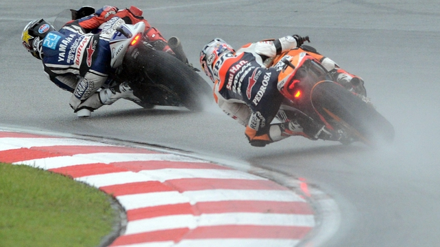 Dani Pedrosa (r) is now just 23 points behind Jorge Lorenzo (l) with two races remaining