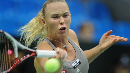Caroline Wozniacki has lost to world-ranked 186th Wang Qiang