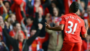 Raheem Sterling celebrates scoring his first goal for Liverpool against Reading