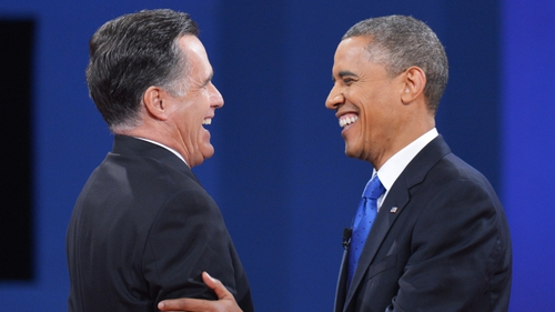 Barack Obama and Republican candidate Mitt Romney shake hands at the end of the third and final presidential debate