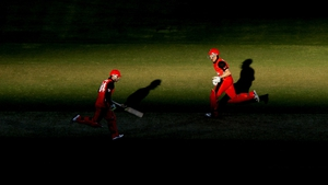 Phillip Hughes and Michael Klinger of the Redbacks run between the wickets during the Ryobi One Day Cup
