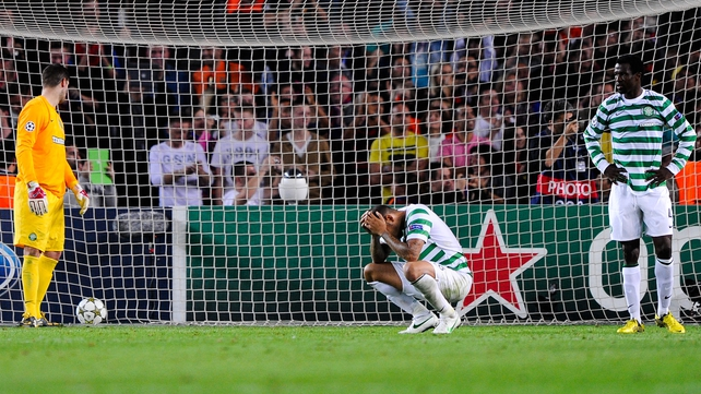 Celtic players distraught after conceding a late goal to Barcelona at the Nou Camp